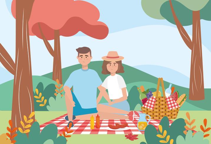 Man och kvinna som har en picknick vektor