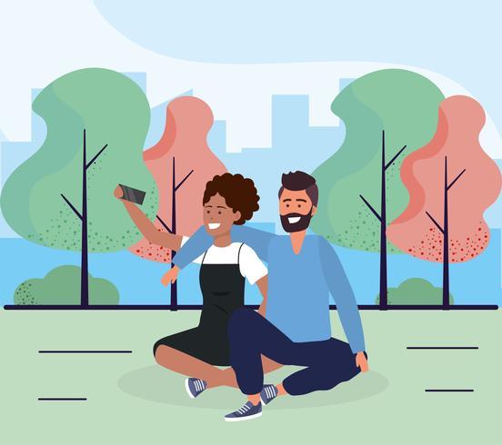 Söta par som tar selfie i park vektor