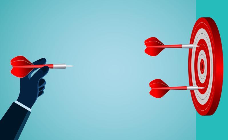 Hand eines Geschäftsmannes, der einen roten Pfeil zum Ziel wirft vektor