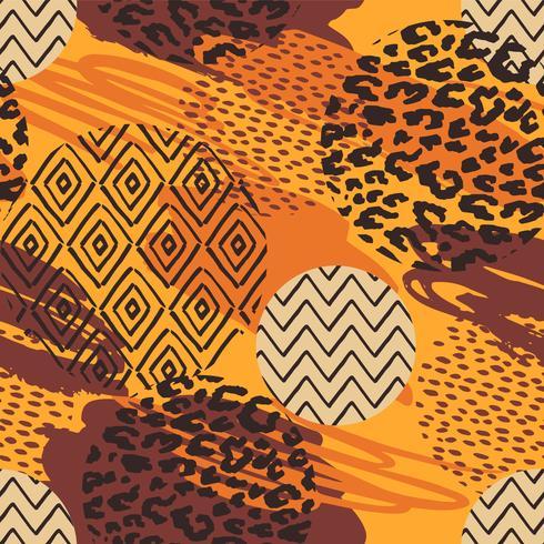 Tribal etniska sömlösa mönster med djurtryck och penseldrag. vektor