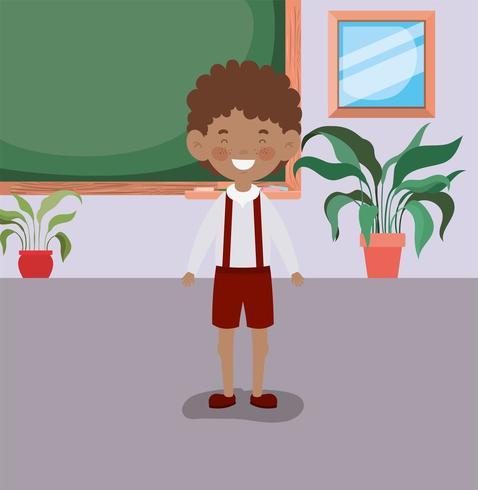 kleiner student junge im klassenzimmer vektor