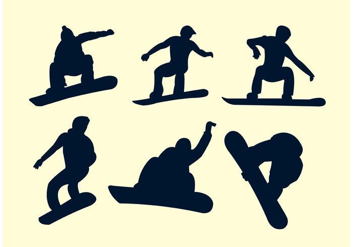 Silhuetter av snowboardåkare vektor