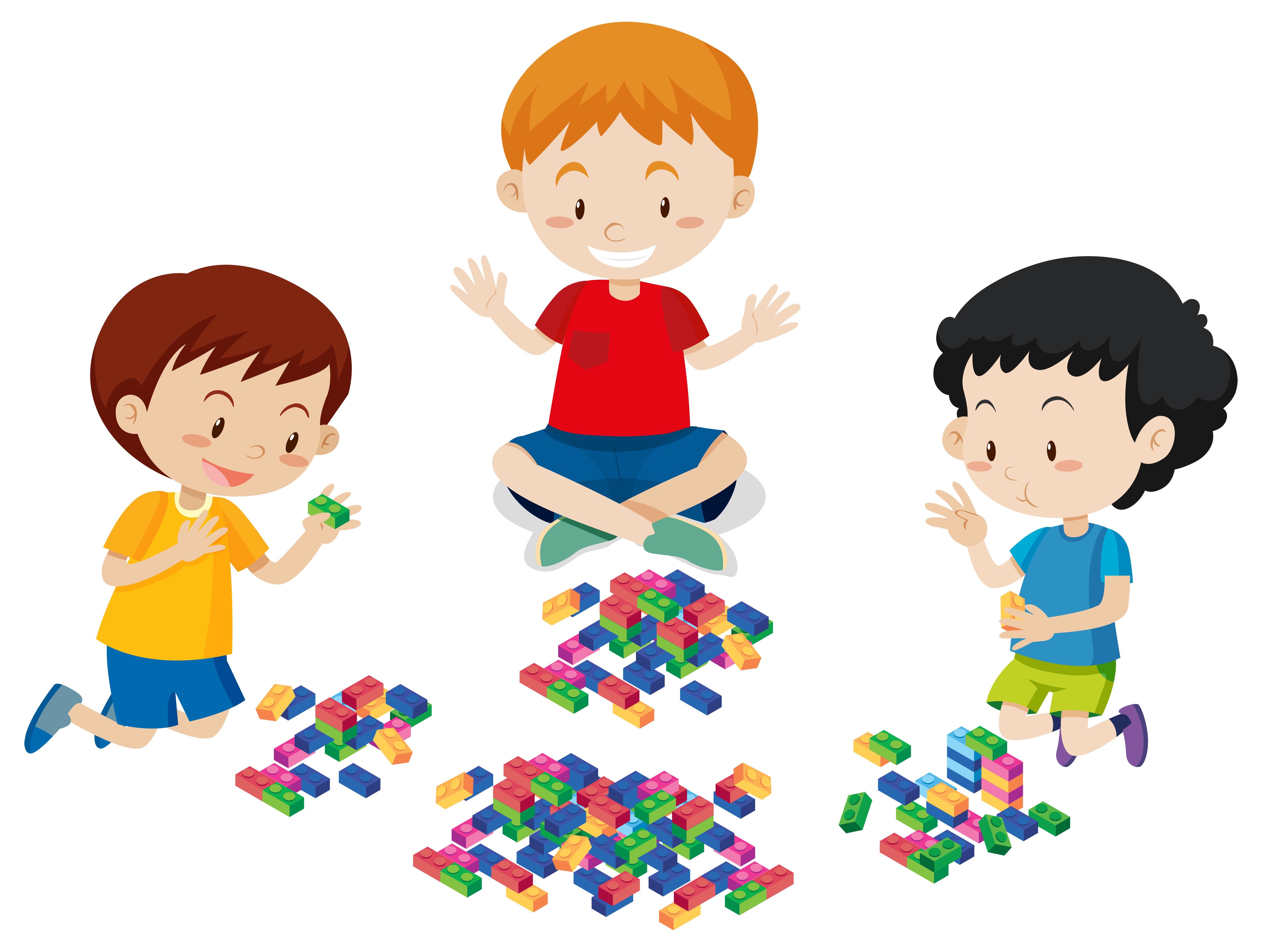 Jungen, die Lego auf weißem Hintergrund spielen 294040