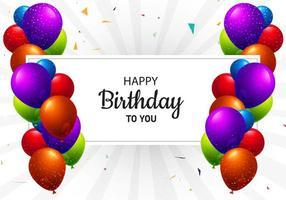 mångfärgade födelsedagsballonger och textram