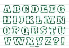 Alfabetet med grönt färgstämpel