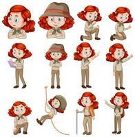 Satz Mädchen mit roten Haaren im Safari-Outfit vektor