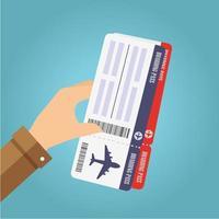 hand som håller boarding pass biljetter