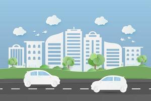 byggnader och allmän park med bilar på väg