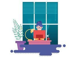 kvinna som arbetar hemma framför fönstret