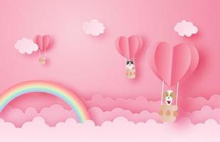 Papierkunsthund und -katze in Luftballons im Himmel