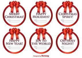 Vektor uppsättning rund etiketter med julmeddelanden och bågar
