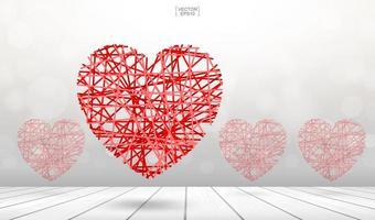 abstraktes gewebtes rotes Herz, das über Holzboden schwimmt