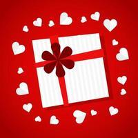 Geschenk mit Papierherzen auf rotem Farbverlauf