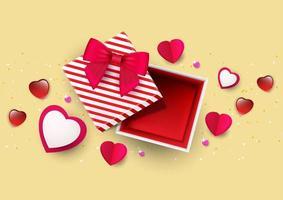 Draufsicht der roten und weißen Herzen und des Geschenks