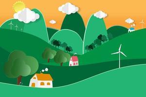 hus i böljande kullar med vindkraftverk