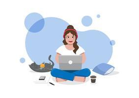 Frau benutzen Laptop, der auf einem Boden mit Katze sitzt