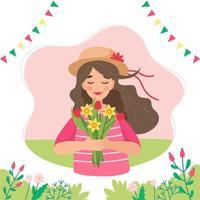 flicka håller blommor på våren
