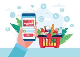 Hand hält Telefon, um Lebensmittel zu kaufen