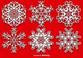 Vektor uppsättning av pixelerade snöflingor
