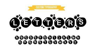 abstrakte Typografie der schwarzen Tintentröpfchen vektor