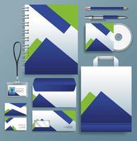 Satz von blauen, grünen stationären Schablonen im grauen Hintergrund