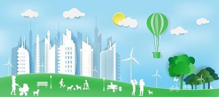 glückliche Familien im Papierstil im grünen Park durch Stadt vektor