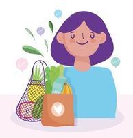 kvinna med påsar med matvaror