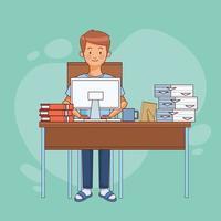 Mann sitzt am Schreibtisch und arbeitet von zu Hause aus