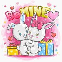 süßes kleines Kaninchenpaar, das mit Geschenken umarmt