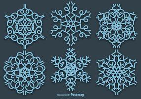 Set med 6 vektorblå snöflingor