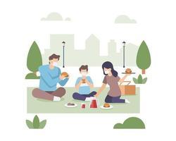 Familie mit Gesichtsmasken, die zusammen im Park essen vektor