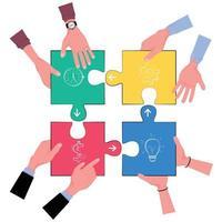 vier Hände halten Puzzleteile in 4 Farben