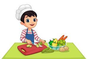 süßer kleiner Junge, der Gemüse schneidet vektor