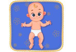 süßes glückliches Baby, das auf Matte liegt