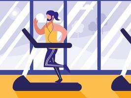 Mann mit Läufermaschine im Fitnessstudio