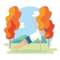 man gör yoga utomhus