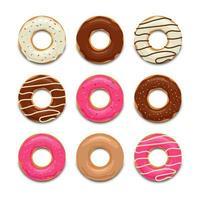 Draufsichtsatz der bunten leckeren Donuts