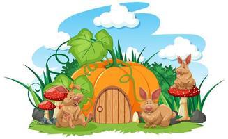 Kürbishaus mit drei Cartoon-Kaninchen vektor