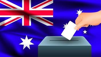 Hand, die Stimmzettel in Kasten mit australischer Flagge setzt