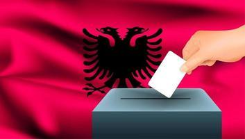 Hand, die Stimmzettel in Box mit albanischer Flagge setzt