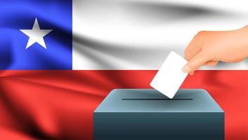 Hand, die Stimmzettel in Box mit chilenischer Flagge setzt
