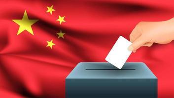 Hand, die Stimmzettel in Box mit chinesischer Flagge setzt