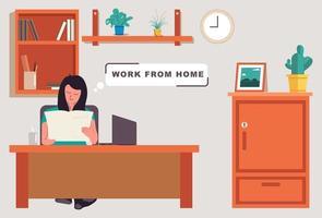 kvinna som läser och arbetar hemma