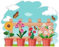 Gartenszene mit schönen Blumen und Schmetterlingen vektor