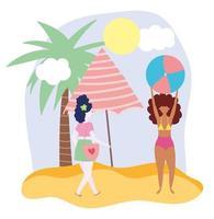 kvinnor som leker på stranden