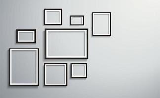 schwarzer Rand unterschiedlich große Bilderrahmen an der Wand vektor