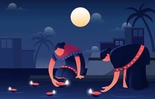 ein paar Frauen, die Diya auf Diwali verbrennen