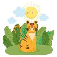 söt tiger sitter på gräset i naturen