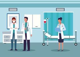 grupp av olika läkare i sjukhusrummet