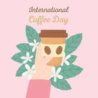 internationaler Kaffeetag. Hand mit Tasse zum Mitnehmen